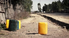 Canister for water near road Stock Footage
