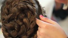 Hairdresser make braids in beauty salon Stock Footage