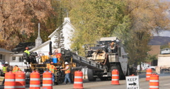 Road workers construction asphalt black top industrial DCI 4K Stock Footage
