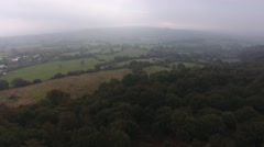 Aerial view of English countryside on a foggy day. Stock Footage