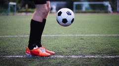 Soccer player playing with ball on field Stock Footage