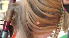 Stylist make curls hair in hair style salon Stock Footage