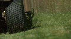 Riding Lawnmower Cutting Grass in Slow Motion Stock Footage