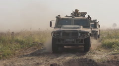 """Russian special forces riding on armored cars """"Tiger"""" Stock Footage"""
