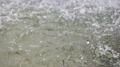 Heavy rain on water shooting high speed camera Stock Footage