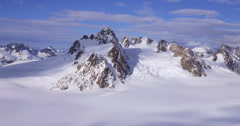 Epic Jagged Mountain Tor over Glaciers Rotation Aerial 2K Stock Footage