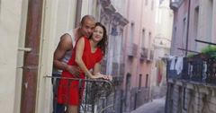 4K Happy couple in hotel or apartment go out onto the balcony to look at the vie Stock Footage