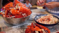People prepare fresh lobster for their dinner at a home Stock Footage