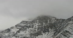 Majestic mountain peak swirling clouds winter storm DCI 4K Stock Footage