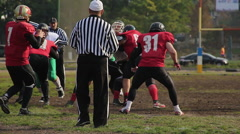 Scrimmage in American football, referee stopping the match, professional sport Stock Footage