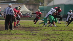 Defence team trying to intercept ball, players running to the end zone, sport Stock Footage