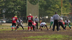 Offense team attacking defense, the beginning of American football match Stock Footage