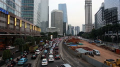 Traffic jam and public bus in Jakarta business district Stock Footage