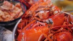 People prepare lobster for their dinner Stock Footage