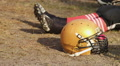 Football player legs and helmet close-up, athlete having rest on stadium field HD Footage