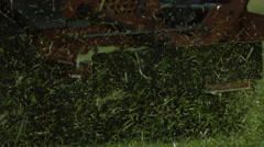 Grass Clippings from Riding Lawnmower Cutting Grass in Slow Motion Stock Footage