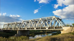 Rushing clouds over the railway bridge. time-lapse railway bridge Stock Footage
