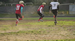 Footballers running on pitch, trying to intercept the ball, active lifestyle Stock Footage
