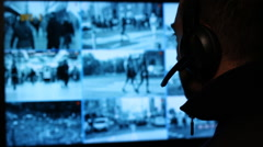 Security officer watching monitoring displays in control room. Security cameras Stock Footage