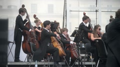 Free Open Outdoor symphony concert conductor and orchestra, Krakow Market Square Stock Footage