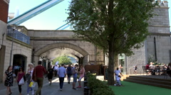 Great Britain England City of London pedestrian walkway under the Tower Bridge Stock Footage