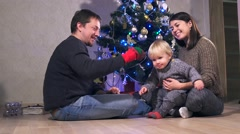 Young happy joyful family. Mother, father and baby boy son dressed in sweaters Stock Footage