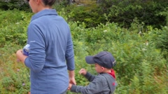 A mother and boy hike the skyline trail Stock Footage