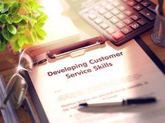 Developing Customer Service Skills on Clipboard. 3D Render Stock Illustration