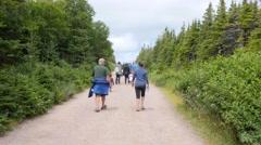 Family hike the skyline trail in Cape Breton Nova Scotia Stock Footage
