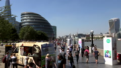 Great Britain England City of London Thames riverfront promenade and city hall Stock Footage