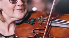 4K Close up portrait classical violinist during orchestra performance Stock Footage