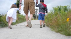 Family hiking on the skyline trail in Cape Breton Nova Scotia Canada Stock Footage