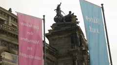 Flags frame statues on Semperoper Stock Footage