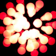 Glowing abstract light spots on dark Stock Photos
