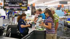 Customer in line in a market at checkout Stock Footage