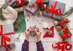 Creative hobby. Wrapping modern handmade christmas present box Stock Photos