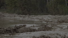 Military armored personnel carrier travels along the muddy road. Dirty armored Stock Footage