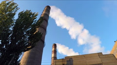 White smoke from the pipes against the blue sky Stock Footage