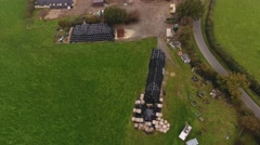 Tilting aerial view of a farm. Stock Footage