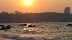 Jet skis swing on the waves. sunset in Pattaya, Thailand Stock Footage