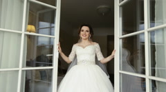 Young happy bride opening the window Stock Footage