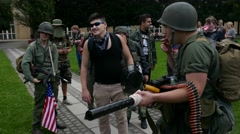 Young millennials making fun out of American US army, make up for zombie walk Stock Footage