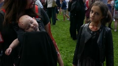 Death body of a baby and her mother preparing to go for a zombie walk in streets Stock Footage