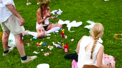Zombie girls make up on grass during preparation phase to go for a zombie walk Stock Footage