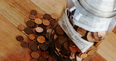 Close-up of coins and currency notes in bottle Stock Footage