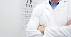 Optometrist standing in ophthalmology clinic Stock Footage