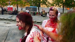 Zombie girls adding blood to each others cloths, preparation for the zombie walk Stock Footage