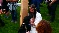 Bloody zombie Jesus playing with dog during the preparation phase of zombie walk Stock Footage