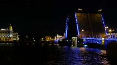 Large ship sail along Neva river, pass by open Palace bridge, illuminated sight Stock Footage