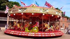 Traditional merry-go-round at Tatton Park, Knutsford, Cheshire, UK Stock Footage